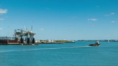 Port of Galveston TX Wide Shot with Oil Rig and Boat in Channel - stock footage