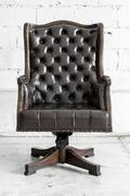 Stock Photo of Black Chair in vintage room