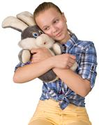 Teen girl embracing the plush toy Stock Photos