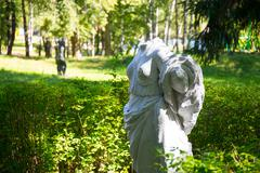Greek classical style statue in the park - stock photo