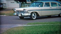 1957: Proud mom and son pull up in new 57' Plymouth car. Stock Footage