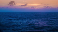 Vibrant Colored Sunset or Sunrise from a Ship at Sea Lower Stock Footage
