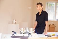 Portrait of smiling female decorator - stock photo