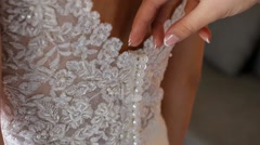 Dressing the bride. Stock Footage