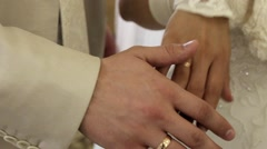 Stock Video Footage of Hands of the bride and groom caress each other.
