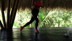 Young woman doing jump exercise in wooden barn Stock Footage