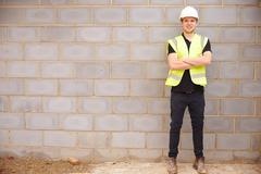 Portrait Of Male Construction Worker On Building Site Stock Photos