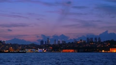 istanbul financial business center at night seen from bosphorus sea - stock footage
