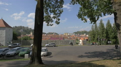 People walking near the restored bastion of Brasov fortress, Brasov Stock Footage
