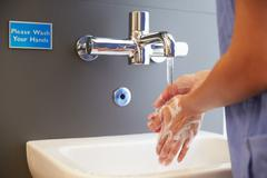 Close Up Of Medical Staff Washing Hands Stock Photos