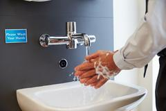 Close Up Of Medical Staff Washing Hands - stock photo
