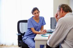 Female Doctor Treating Patient Suffering With Depression Stock Photos