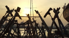 Rusty iron pier in the background of sea and sunset.Bird flies in slow motion Stock Footage