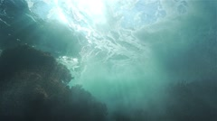 sea wave crashed into the water and spectacular form of turbulence bubbles - stock footage