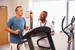 Patient Using Treadmill In Hospital Physiotherapy Department Stock Photos