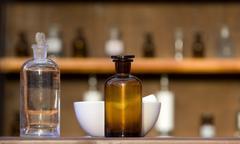 Old-fashioned pharmacy bottles - stock photo