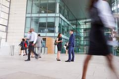 People passing through the busy foyer of a business building Stock Photos
