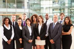 Group portrait of serious corporate business colleagues Stock Photos