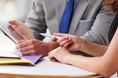 Two corporate business colleagues at work, close up of hands Stock Photos