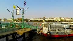 Passengers embarking and disembarking from boat on Chao Phraya river. Bangkok. Stock Footage