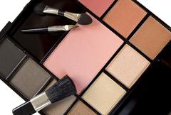 Multi colored make-up and brushes Stock Photos