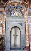 Old monastery door bible murals Stock Photos