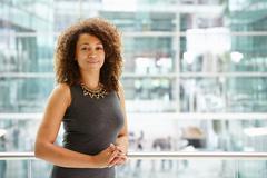 African American businesswoman portrait, waist up - stock photo