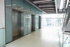 Elevators in the empty corridor of a corporate business Stock Photos
