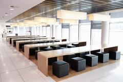 Seating in the empty cafeteria of a large business - stock photo