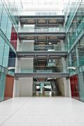 Empty, modern atrium of a large corporate business - stock photo