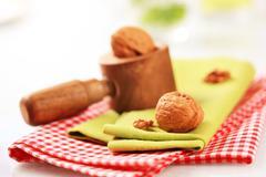 Wooden nutcracker and table linens Stock Photos