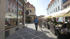 Outdoors restaurants on Republicii street and Diaconu Coresi street, Brasov Stock Footage