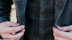 Male hands buttoned jacket Stock Footage