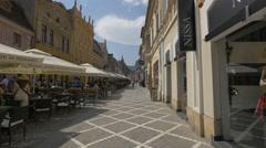 Republicii street - pedestrian walkway with outdoor restaurant and shops, Brasov Stock Footage