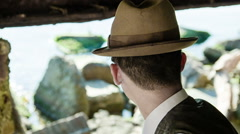 A young man with a hat turns Stock Footage