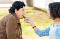 Stock Photo of Lovely hispanic grandmother and granddaughter enjoying quality time outdoors