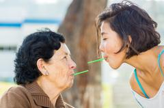 Closeup lovely hispanic grandmother and granddaughter enjoying quality time Stock Photos