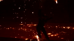 Silhouette of a woman who dances of fireworks Stock Footage