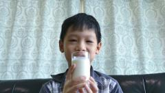 Young Asian boy drinking a glass of milk Stock Footage