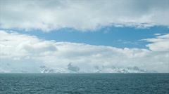 Sunny Antarctica Landscape Wide Shot with Blue Sky Opening - stock footage