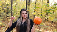 Beautiful witch with a pumpkin Stock Footage