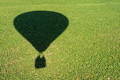 Shadow of an hot air balloon Stock Photos