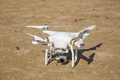 Drone standing in the sand at the beach Stock Photos