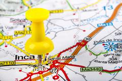 Stock Photo of yellow thumbtack in a map. travel destinations