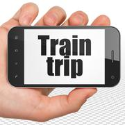 Stock Illustration of Tourism concept: Hand Holding Smartphone with Train Trip on display