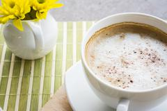A cup of coffee or hot coffee on wooden table , soft-tone , focus at a cup of - stock photo