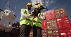 An attractive businesswoman and a manager doing inspections at a busy dock. Stock Footage