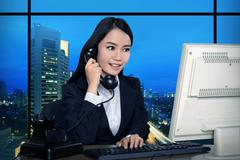 Business woman working late Stock Photos