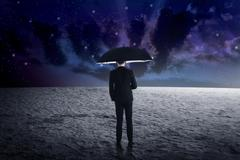 Man holding umbrella from outer space Kuvituskuvat