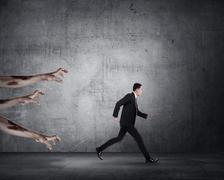 Business man running with zombie Stock Photos